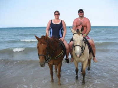 Horseback riding on the beach, a tour attraction in Cape Town, South Africa