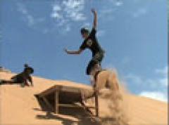 Sandboarding at Mount Mayhem, a tour attraction in EGoli iNingizimu Afrika